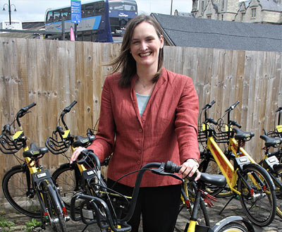 Angela Terry, founder of One Home, with the community bike