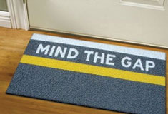 'Mind the Gap' door mat