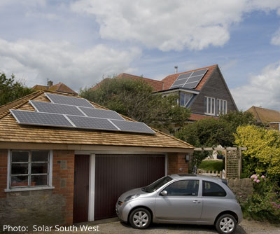 Solar panels on house and garage roofs