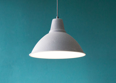 White pendent light against a turquoise wall